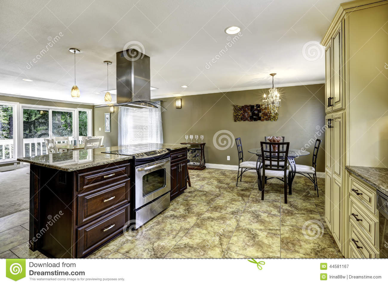 Beautiful kitchen island with granite top and hood stock for Beautiful kitchen room images