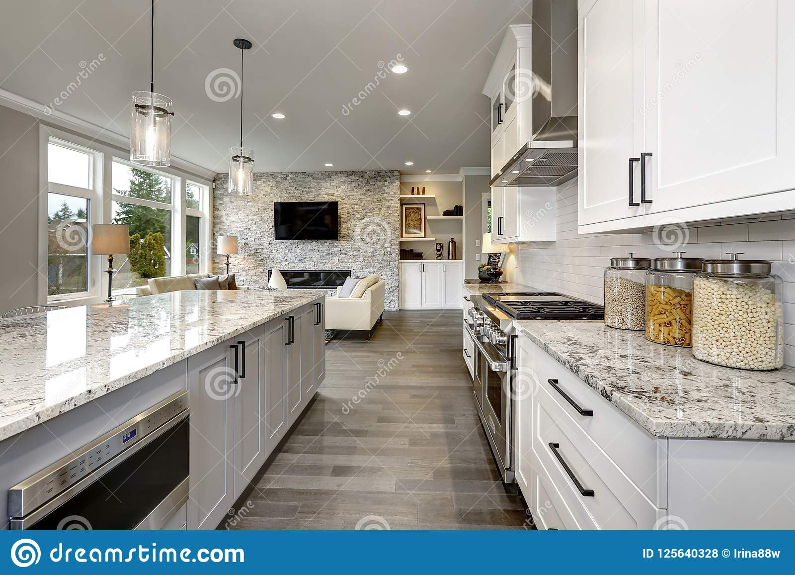 Beautiful kitchen in luxury home modern interior with island and stainless steel chairs