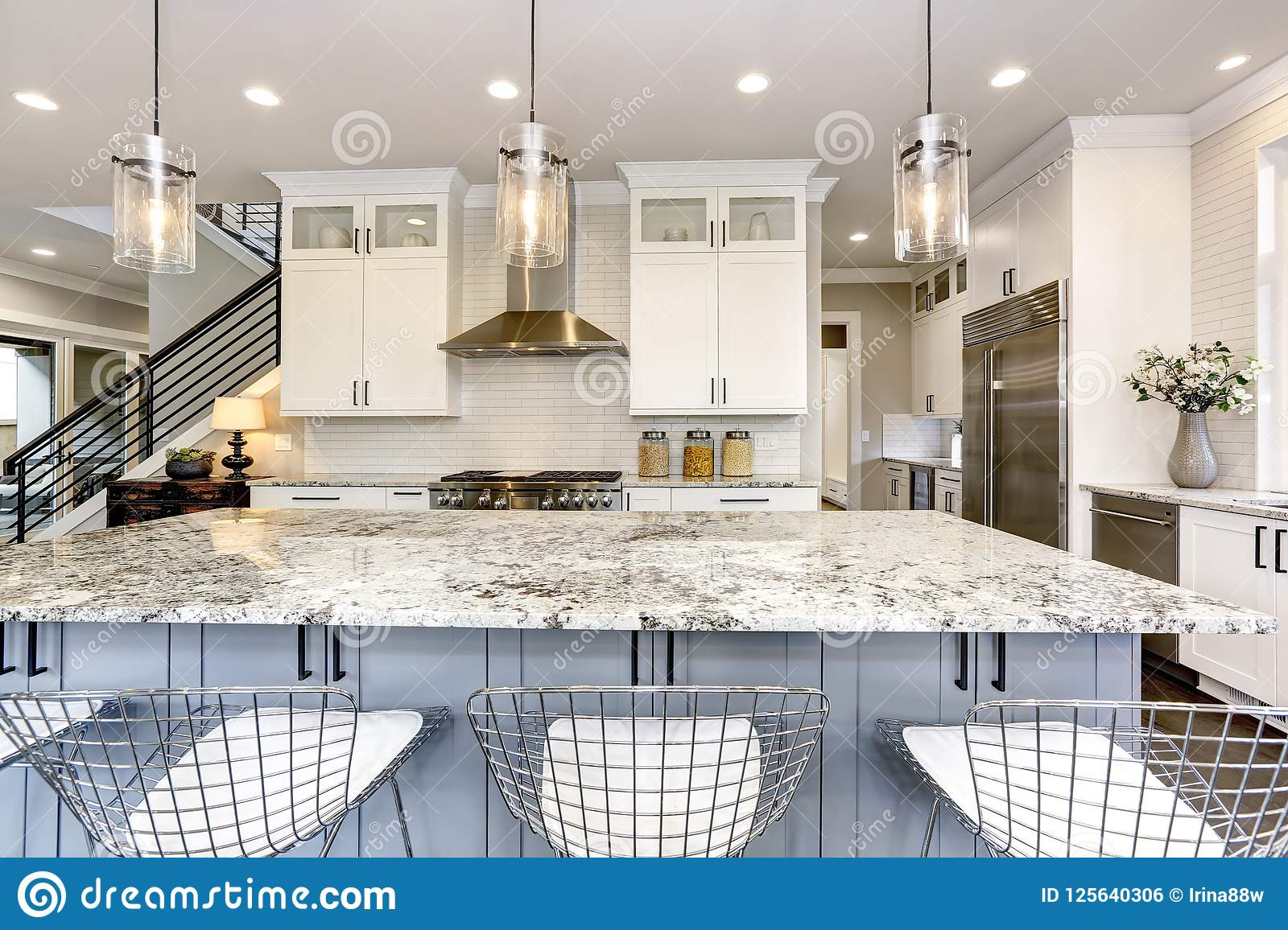 Beautiful Kitchen In Luxury Modern Home Interior With Island Stock