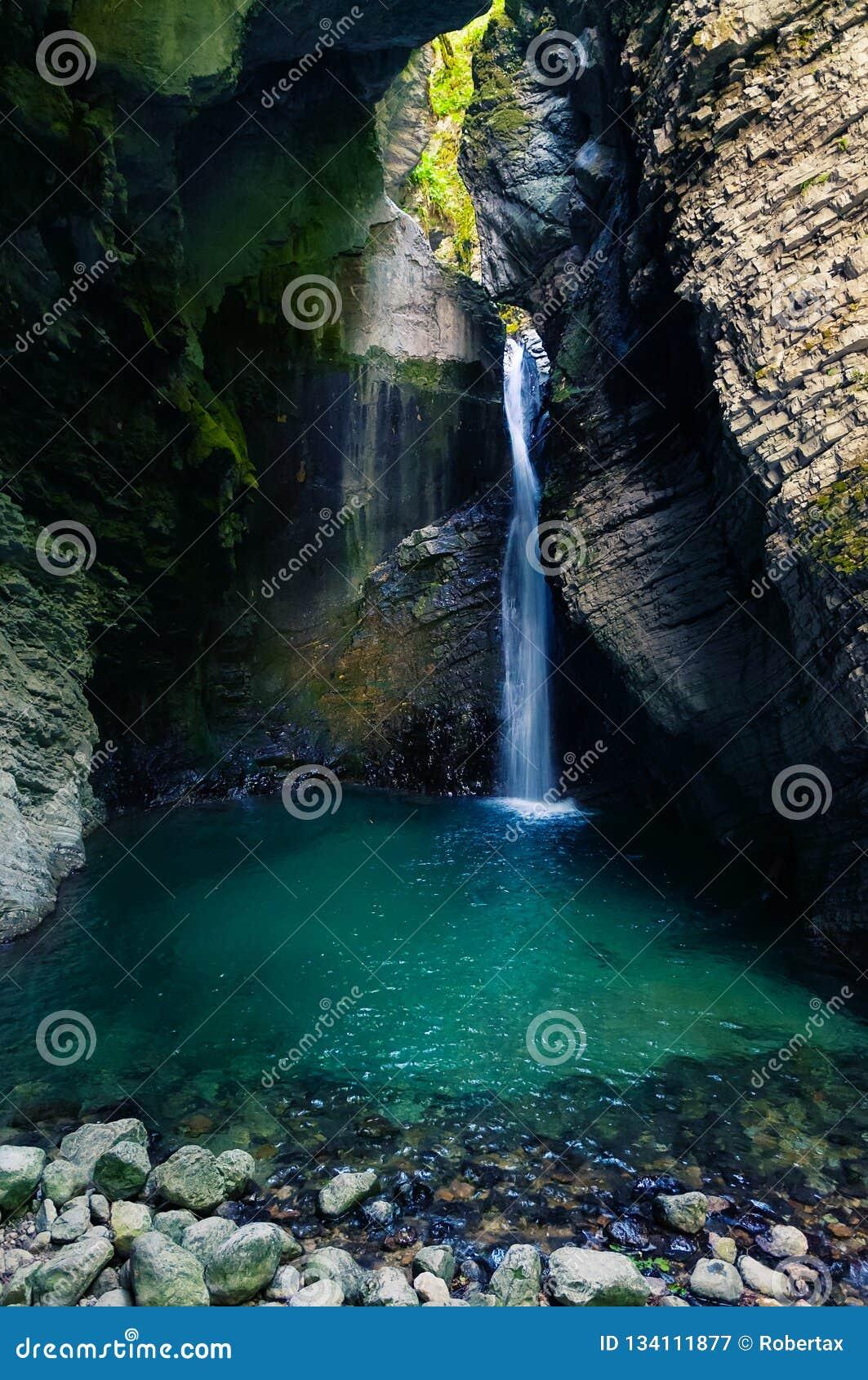 Beautiful Kozjak waterfall hidden in canyon near Kobarid in Slovenia
