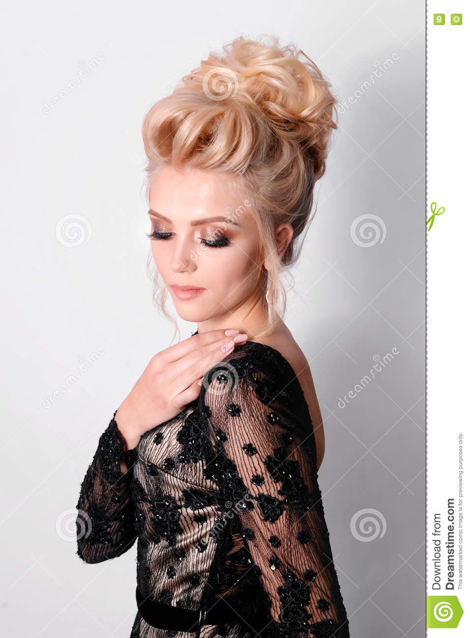 beautiful lady in elegant black evening dress with updo hairstyle