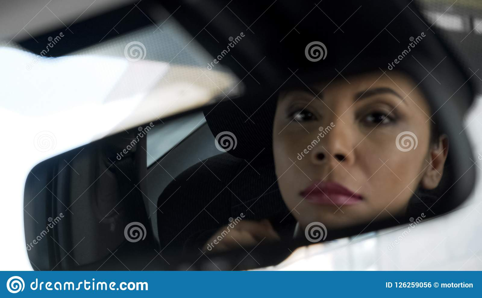 Beautiful Lady Reflection In Rear-view Mirror Of Car