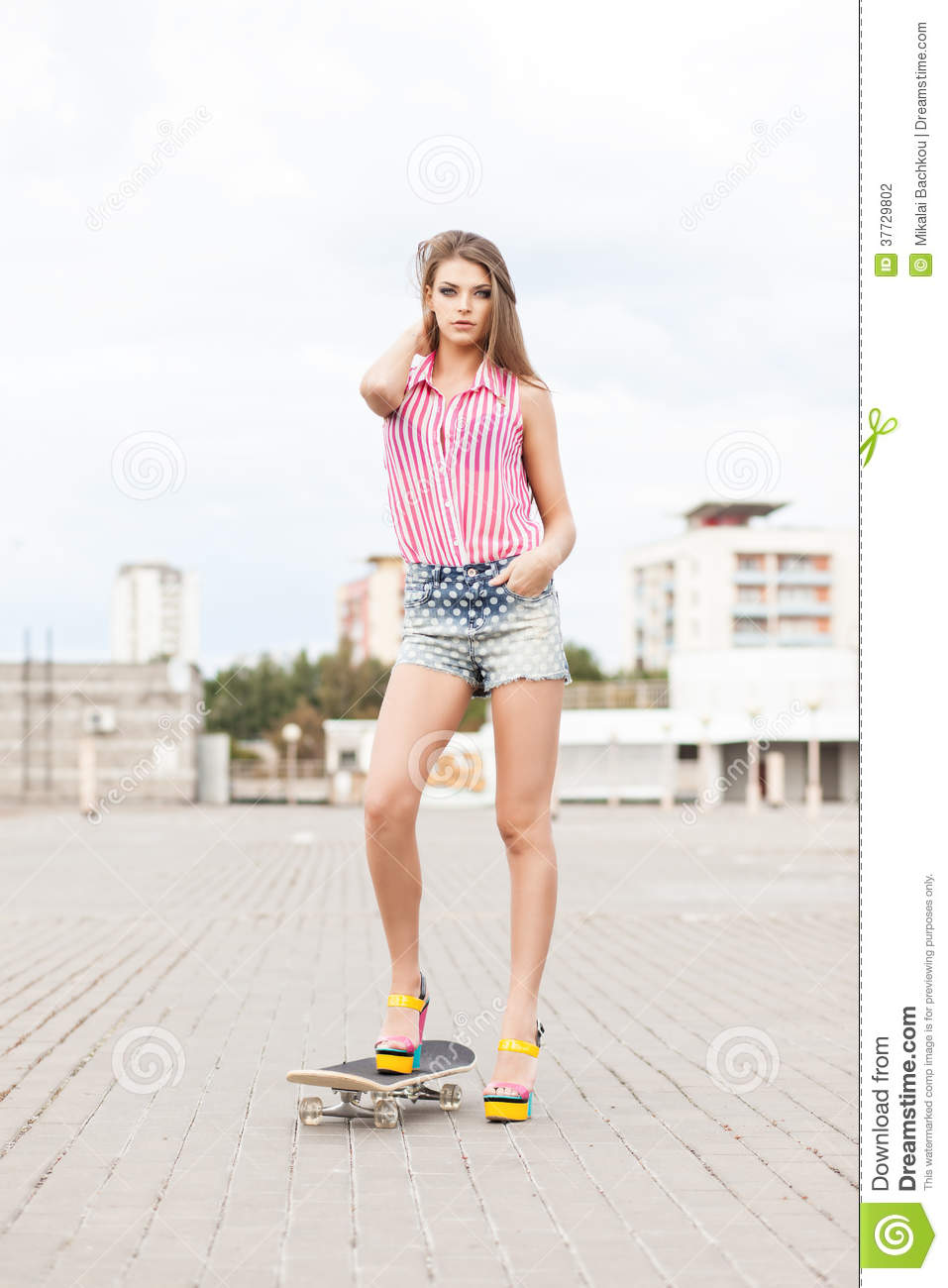 Beautiful Lady In Short Jeans Shorts Stands On Skateboard Stock ...