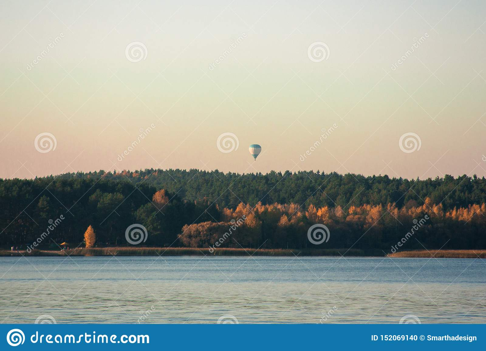 Beautiful Lake Landscape Balloon And Sunset Blue Waves Boat And Horizon Line On Water Beautiful Background Stock Photo Image Of Nature Natural 152069140