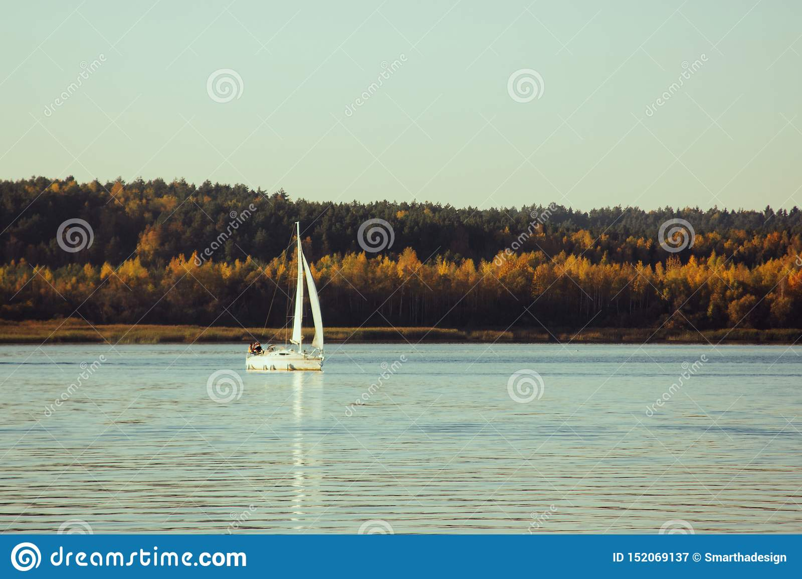 Beautiful lake landscape, yacht, and sunset. Blue waves, boat and horizon line on water. Beautiful background
