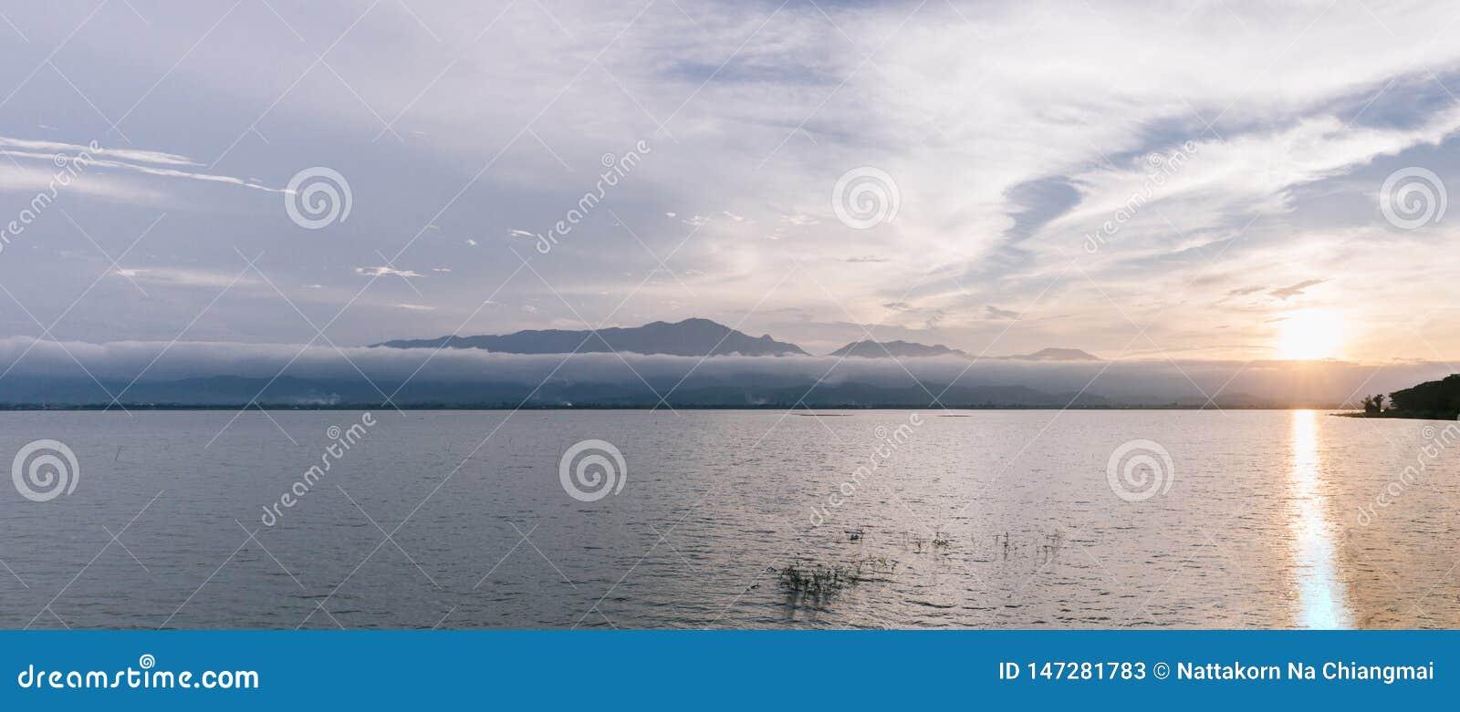 Beautiful lake and mountain during sunset landscape in Panorama at Phayao Lake.