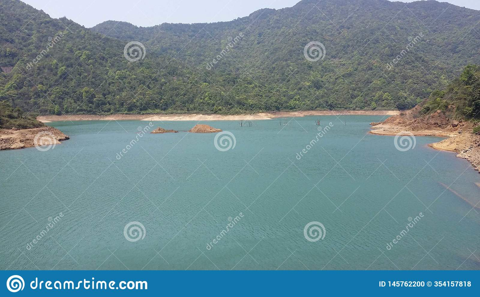 The beautiful lake is surrounded by mountains