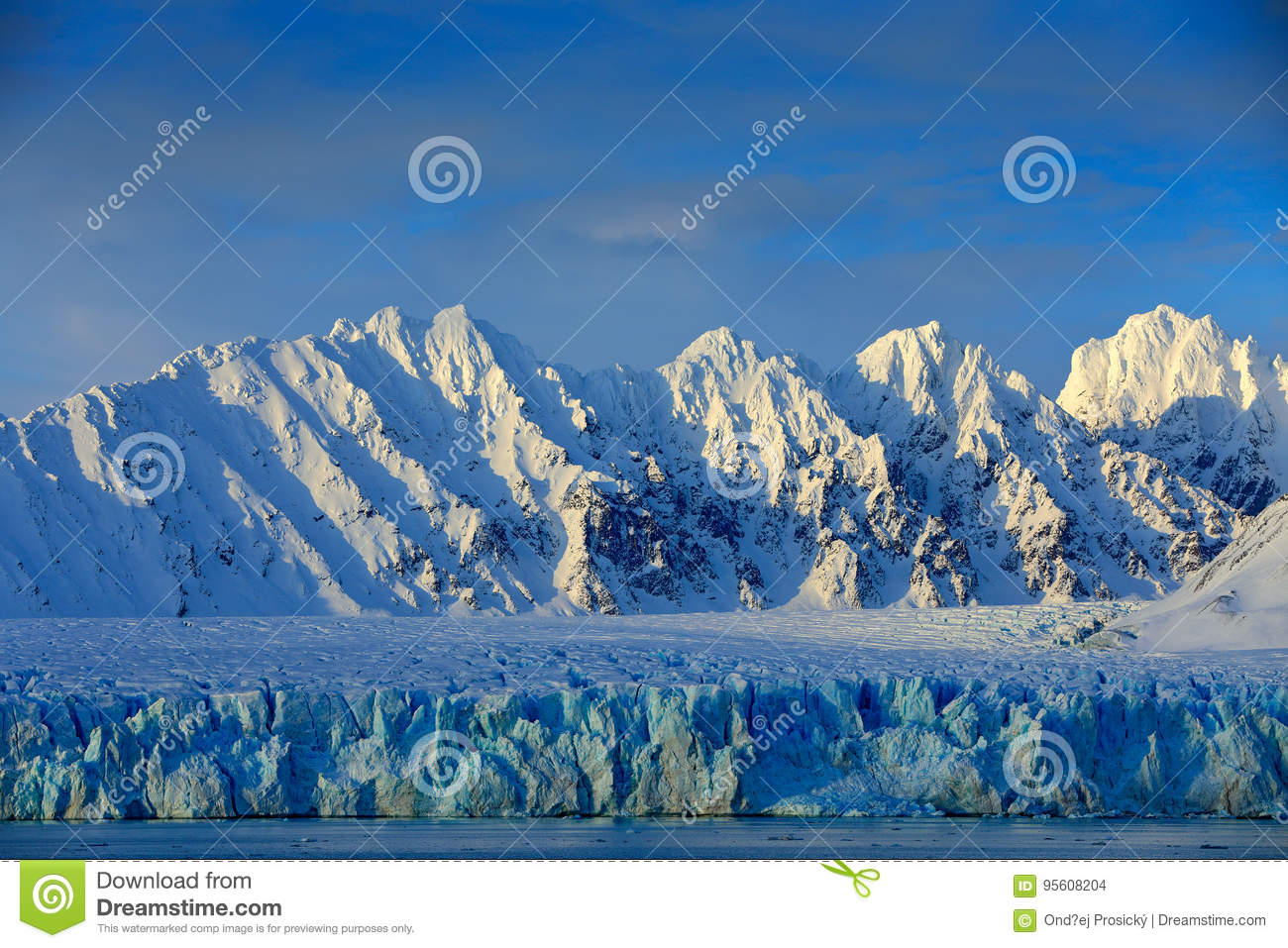 Beautiful landscape. Cold sea water. Land of ice. Travelling in Arctic Norway. White snowy mountain, blue glacier Svalbard, Norwa