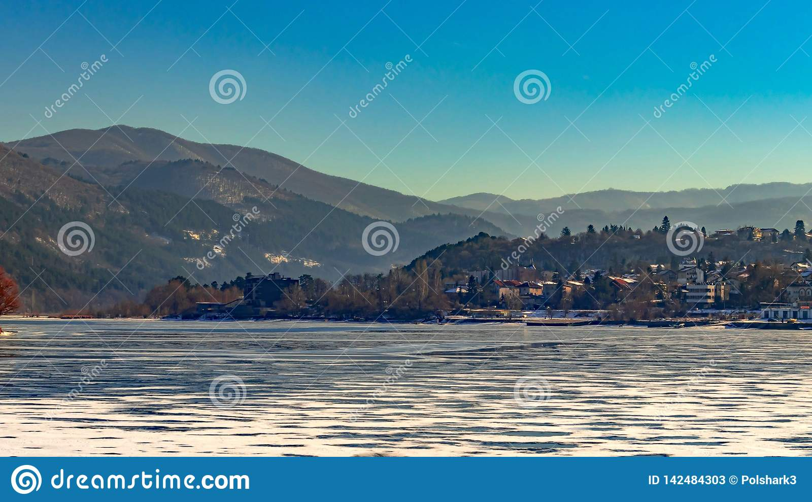 Beautiful landscape, frozen lake covered with snow, beautiful mountains