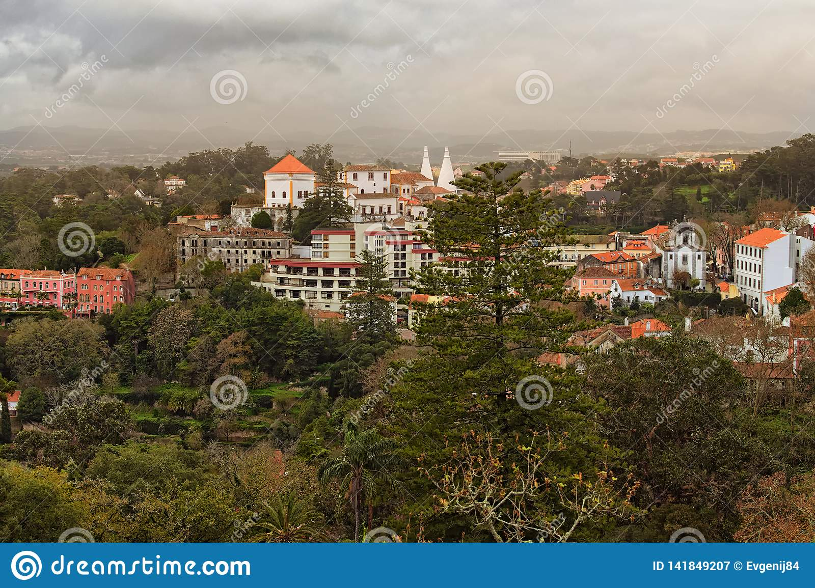 Beautiful landscape photo of medieval Sintra and stunning nature round it. Dramatic sky with thunderclouds