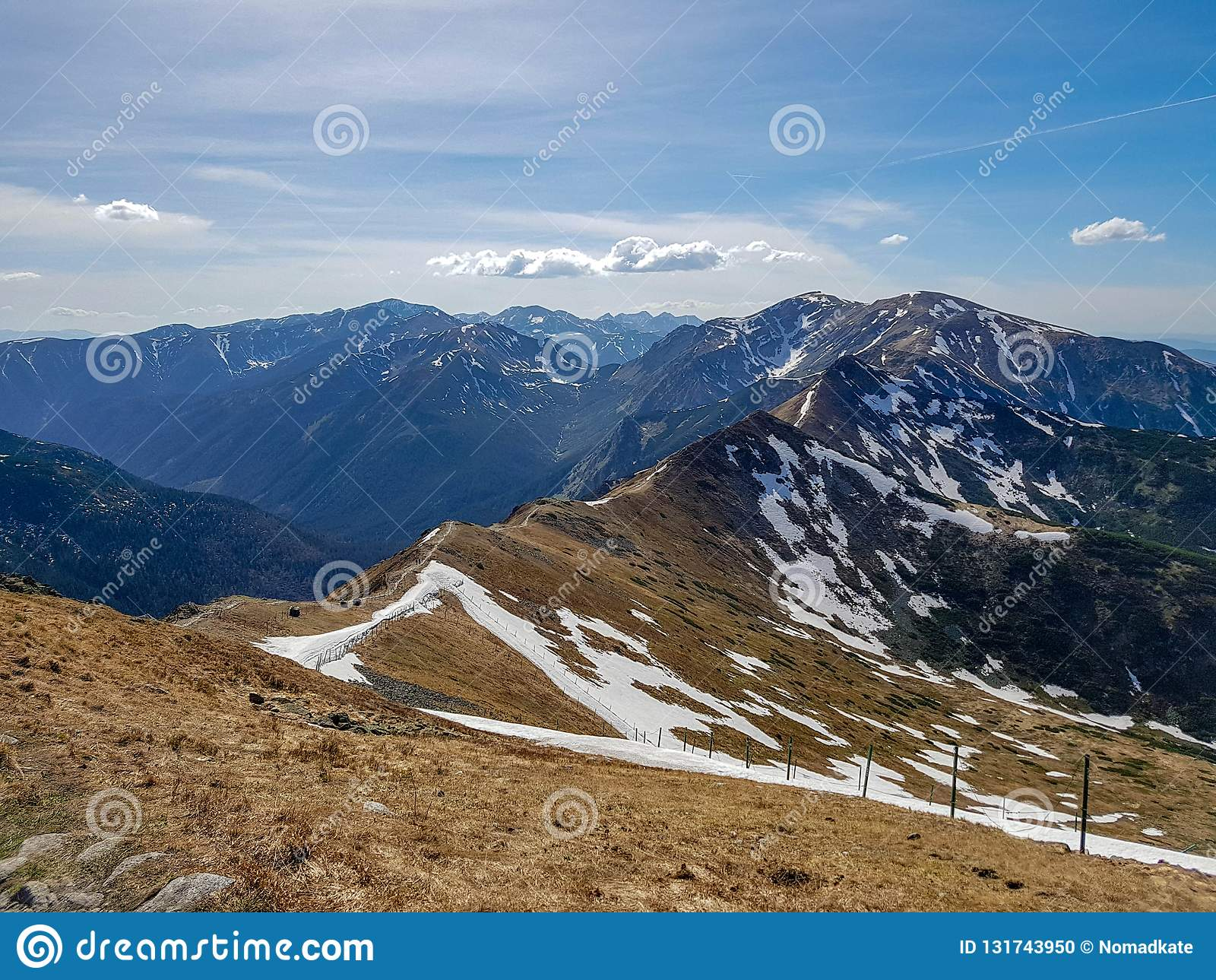 Beautiful landscape of Tatra National Park with mountains in sunny spring day with blue sky nearby Zakopane village, Poland