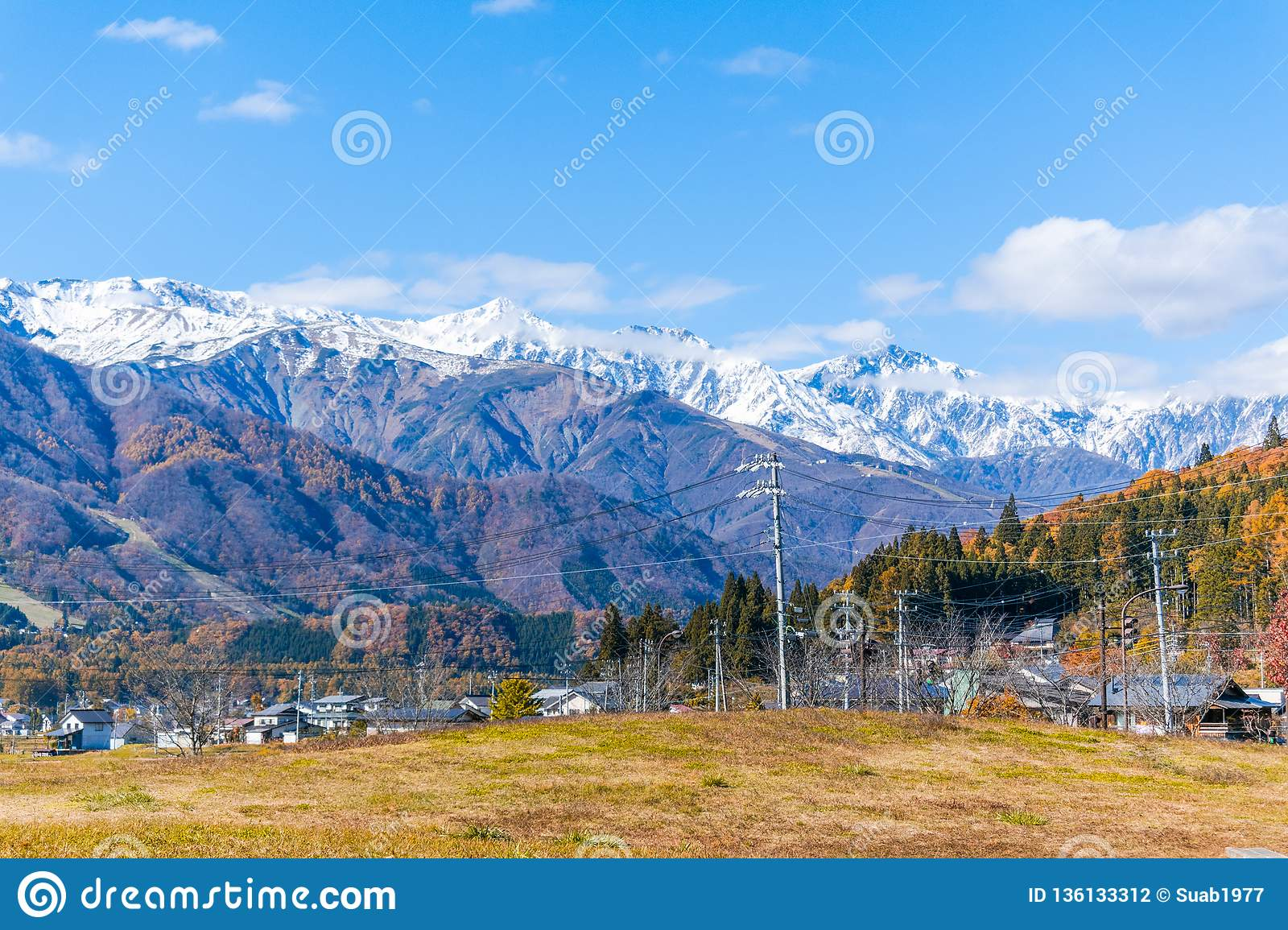 Beautiful landscape view of Hakuba in the winter with snow on the mountain and blue sky background in Nagano Japan