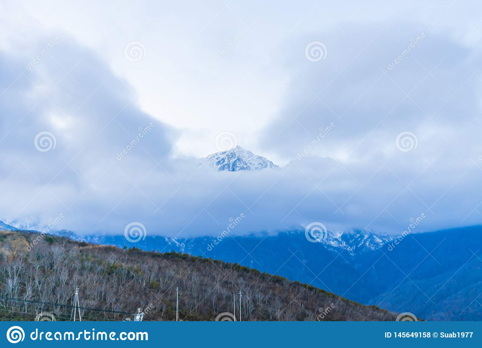 Beautiful landscape view of Hakuba in the winter with snow on the mountain and blue sky background in Nagano Prefecture Japan