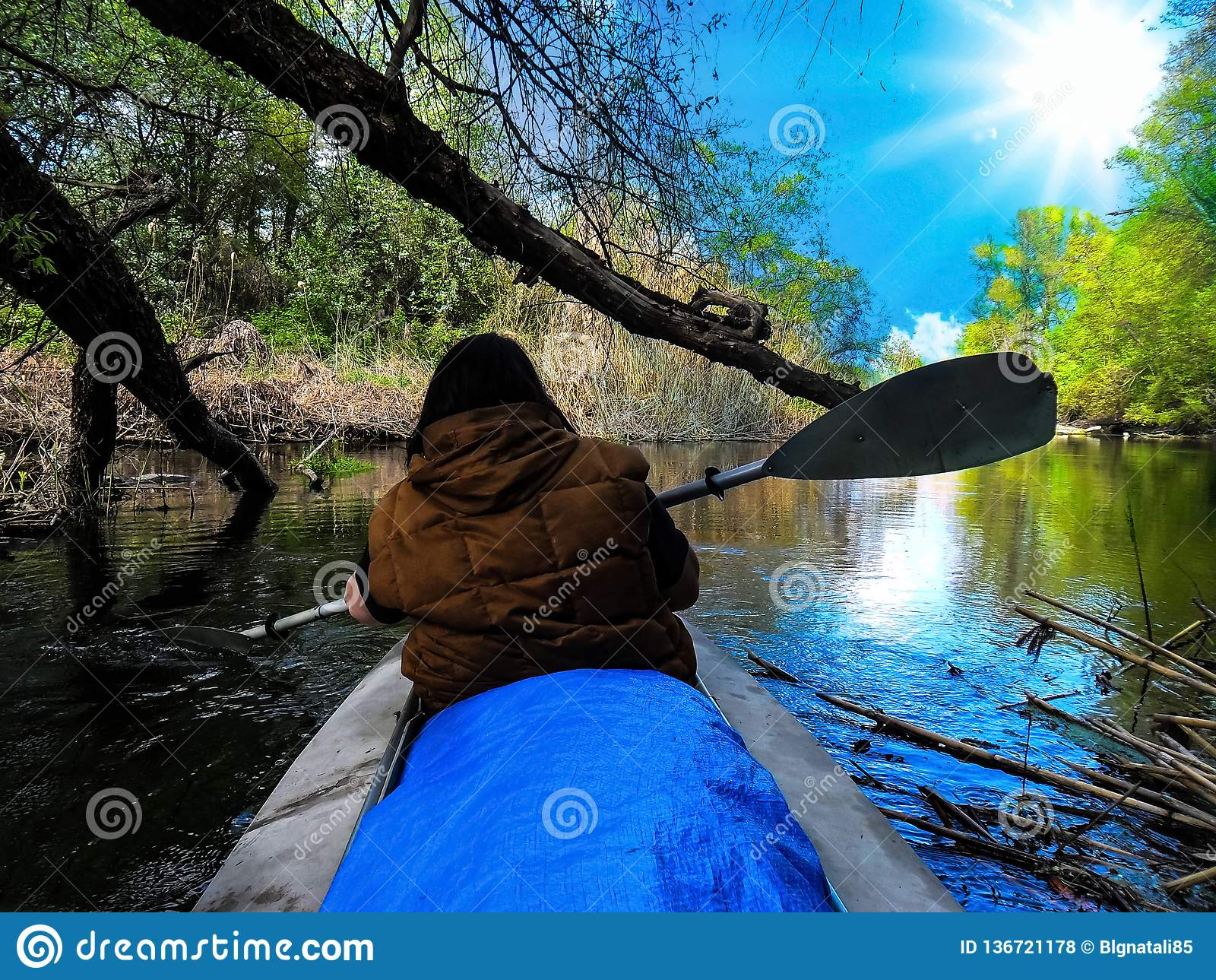 A beautiful landscape of a woman athlete is swimming in a river near Badark