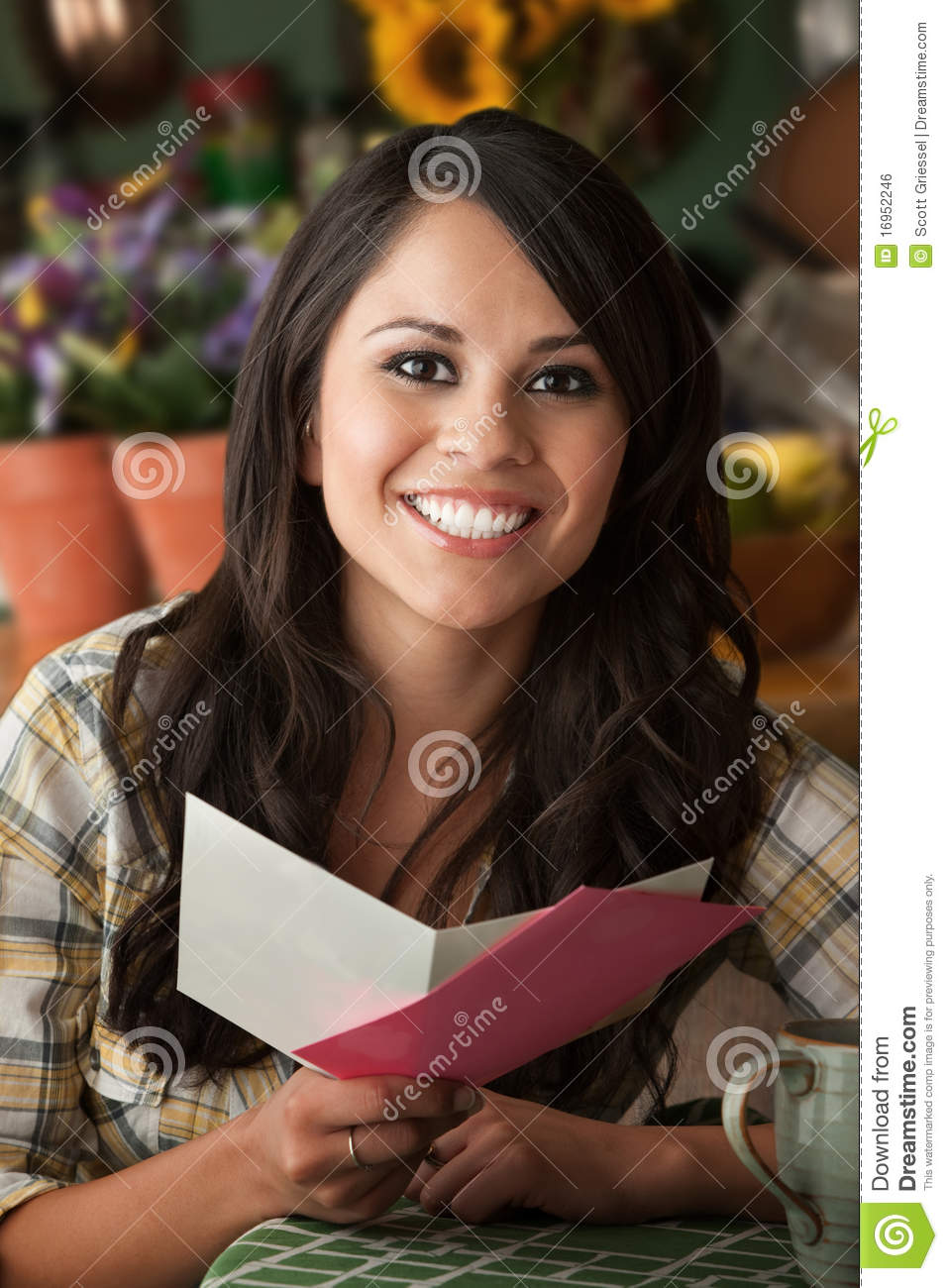 beautiful latina woman with greeting card stock photo