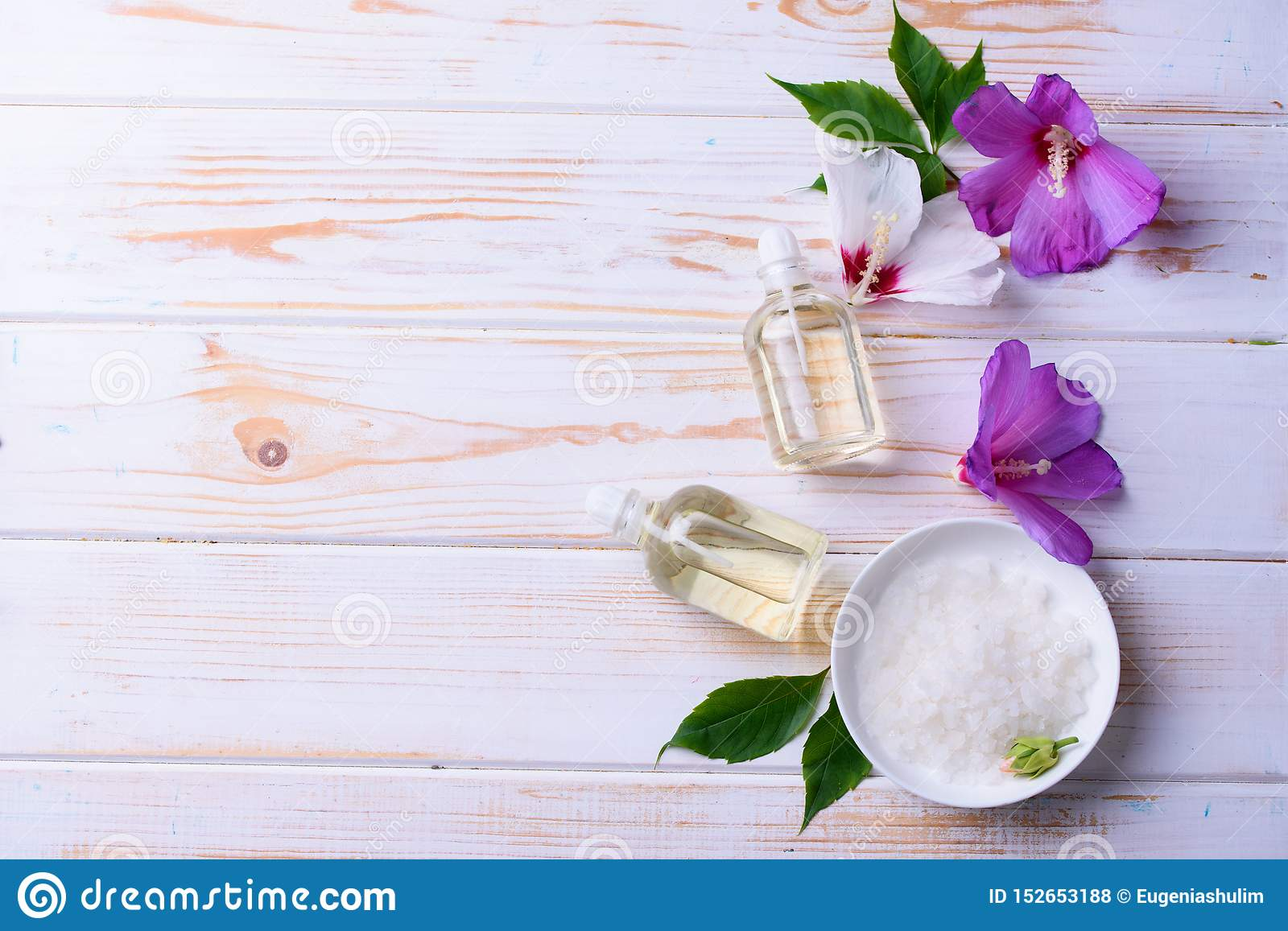 Beautiful layout of cosmetic oils on a wooden background. Natural cosmetics for face and body