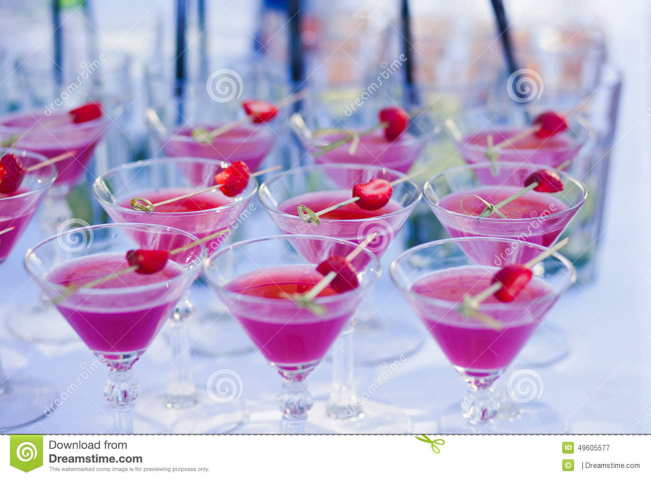 Beautiful line of different colored alcohol cocktails with for Party drinks with tequila