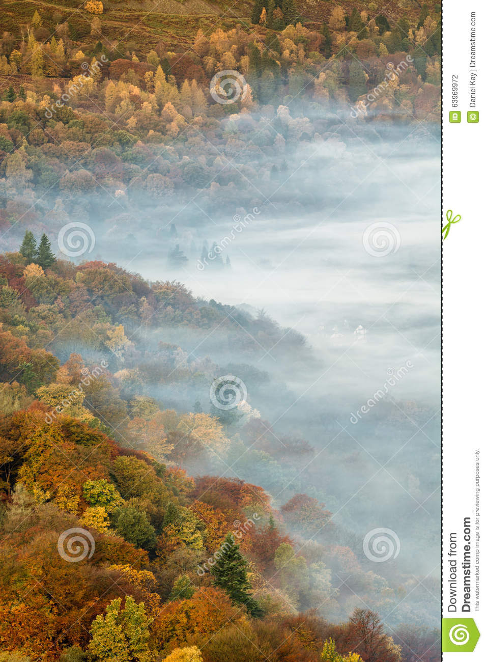 Beautiful Lingering Fog Over Grasmere Lake With Autumnal Colors In Trees.
