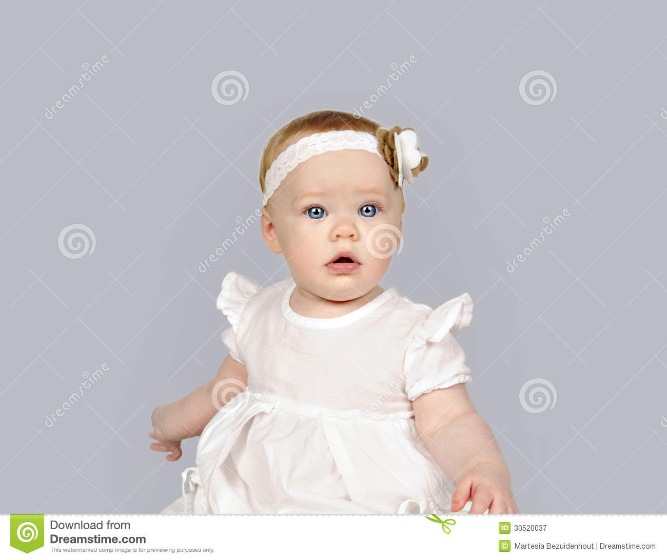 Beautiful Little Baby Girl In A White Dress Royalty Free