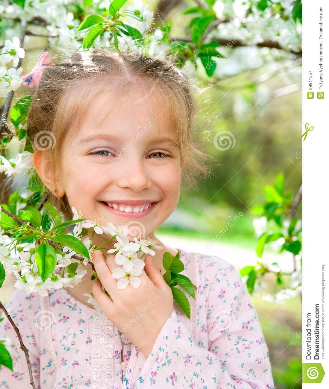 Little Girl With Bush Blossoming Tree Royalty Free Stock
