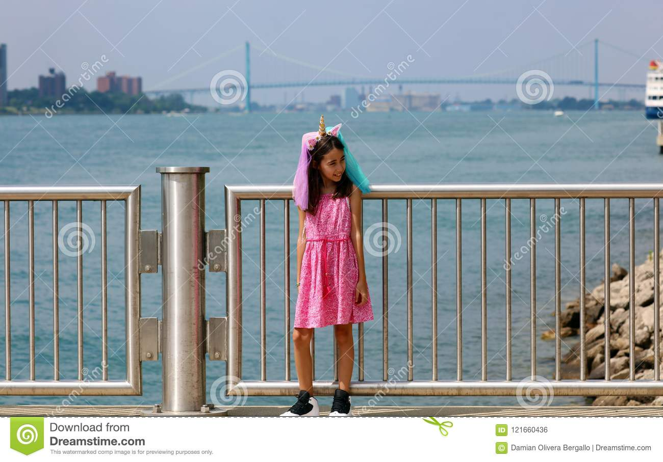 Beautiful little girl at Detroit Michigan, high definition picture of the Ambassador bridge between USA and Canada
