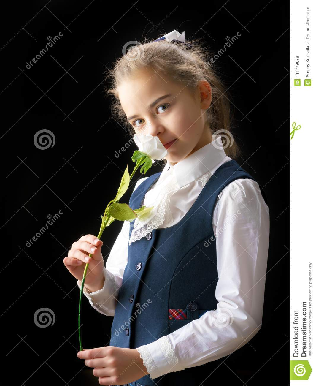 Little girl with a flower in her hand.