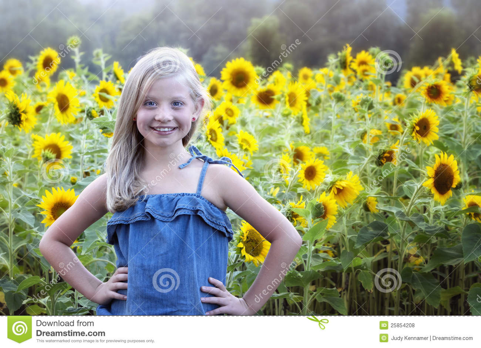 Beautiful little girl in front of sunflower field