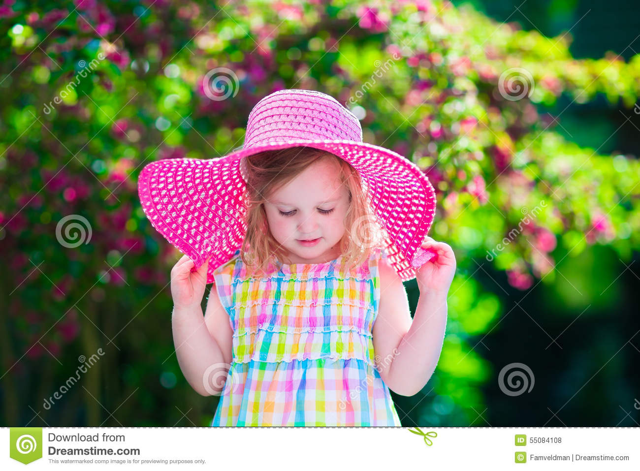 Beautiful Little Girl In A Hat In Blooming Summer Garden Stock Photo ... db4d6a57f35
