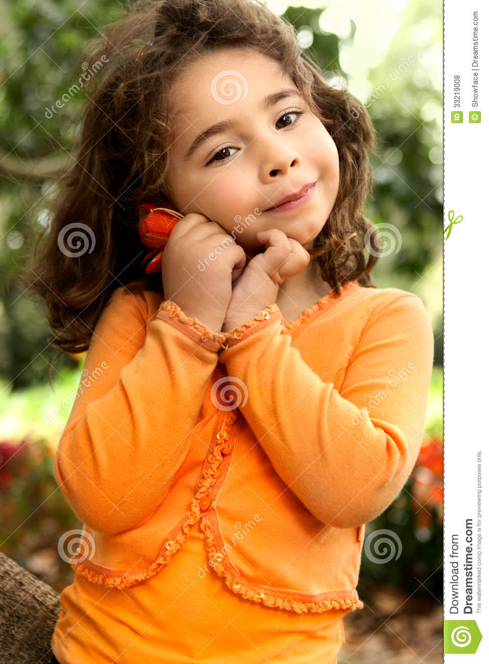 Beautiful Little Girl Holding A Flower Picked From The