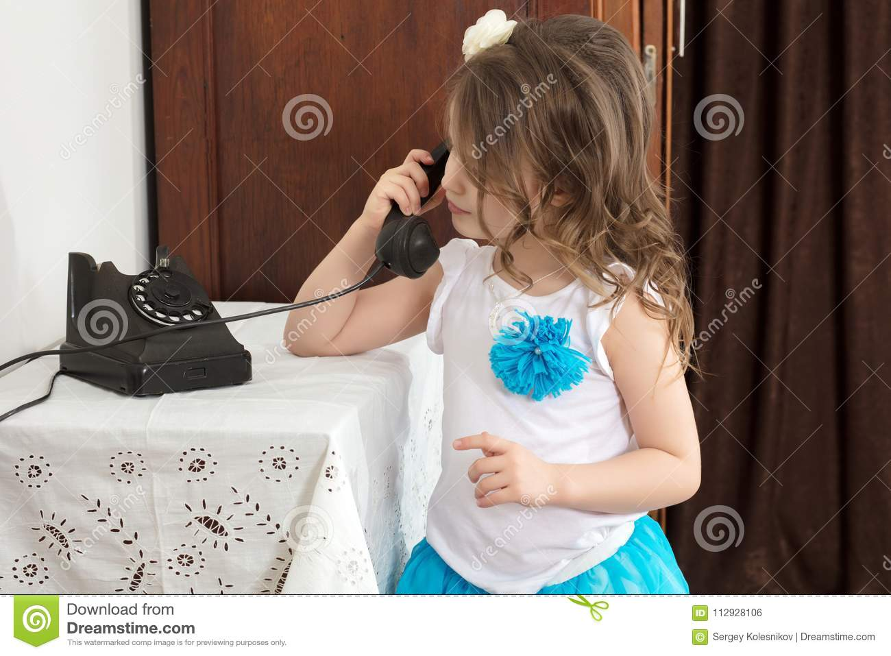 The Girls Ringing On The Old Phone  Stock Photo - Image of