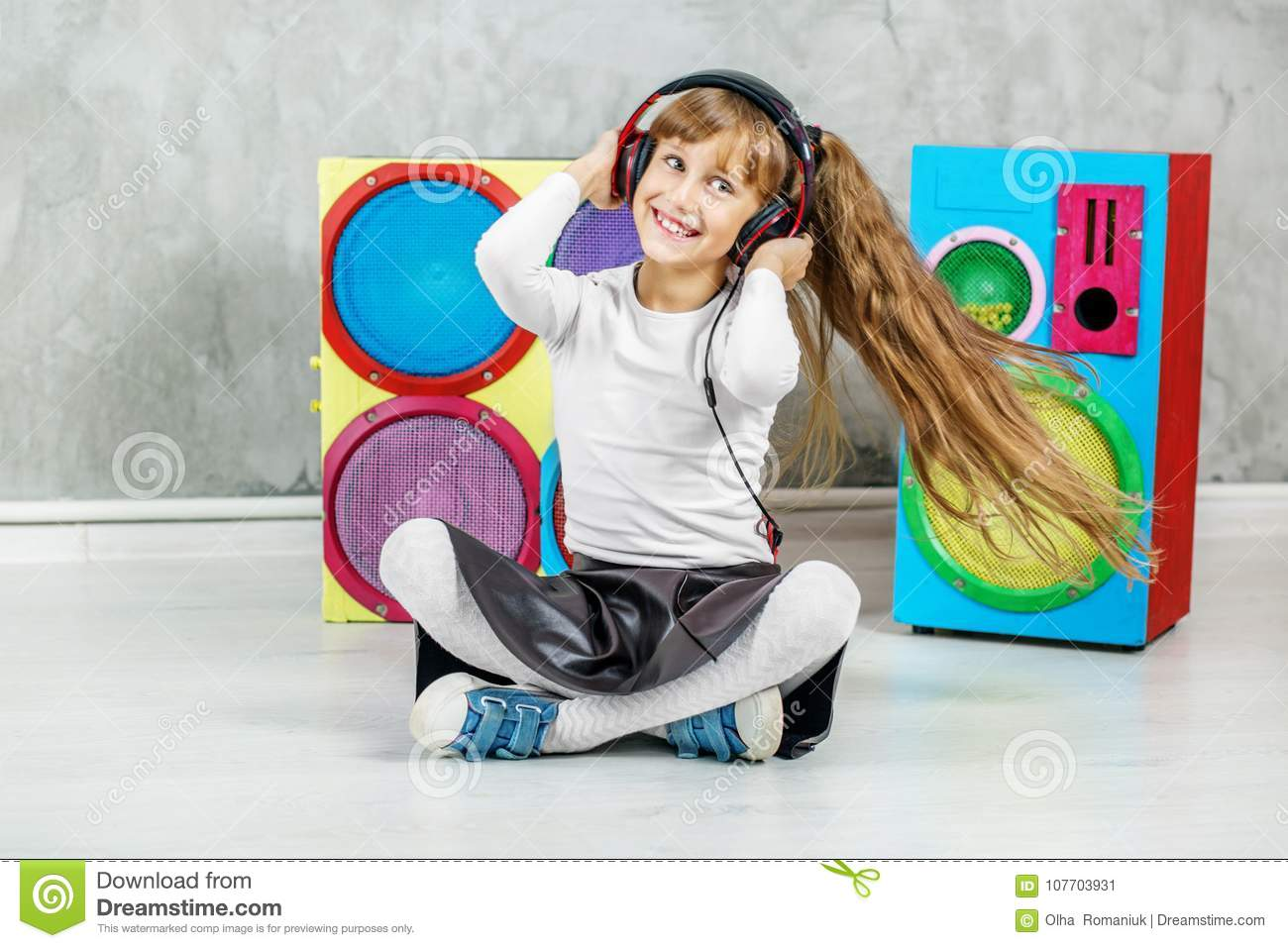 Beautiful little girl listening to the radio with headphones and