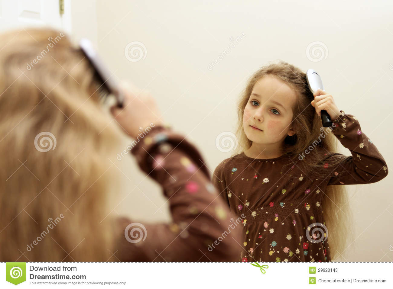 Cute little girl brushing hair while looking in the mirror for Mirror 7th girl