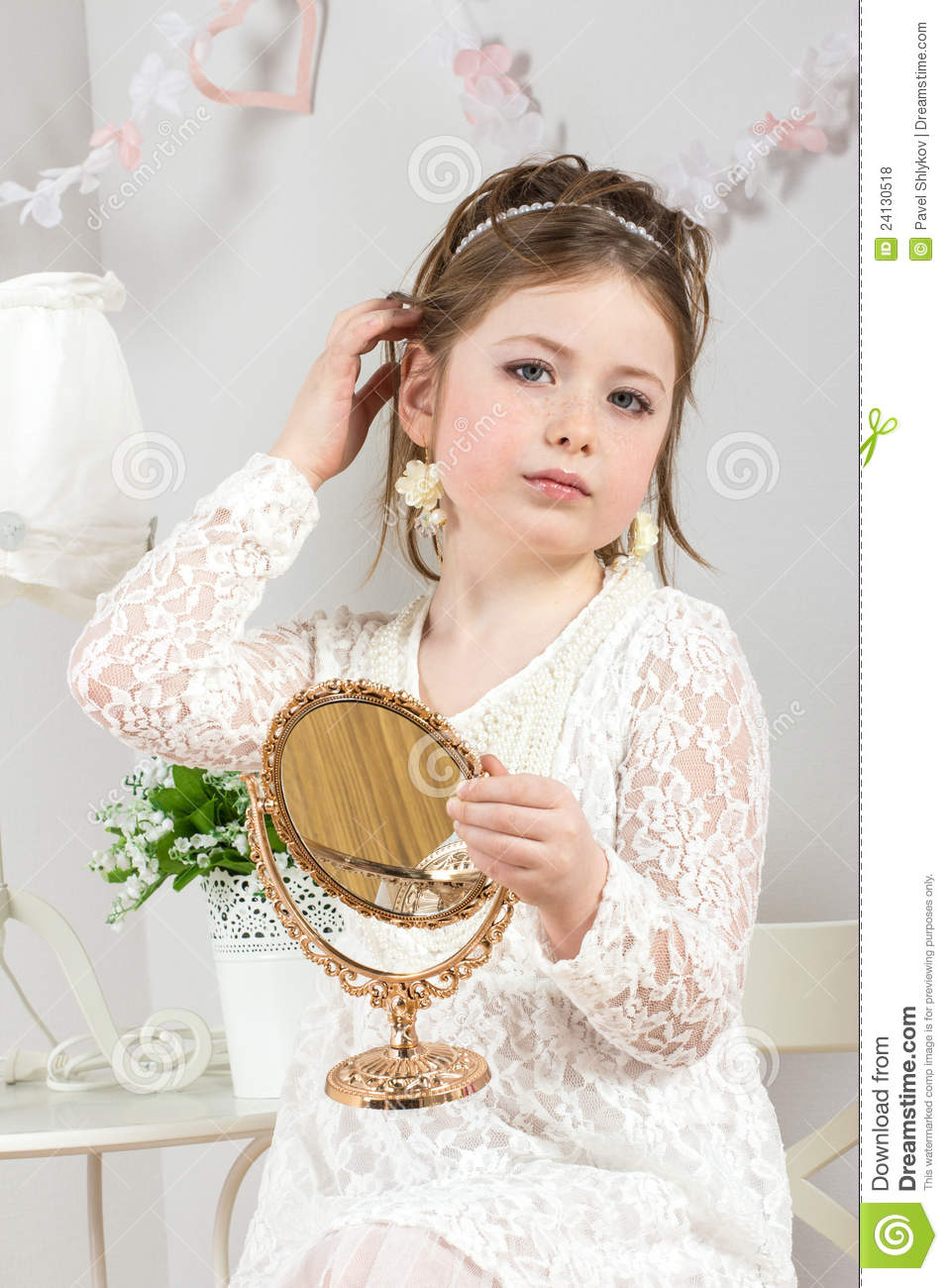 Little Beauty Royalty Free Stock Images: A Beautiful Little Girl Looking To Small Mirror Stock