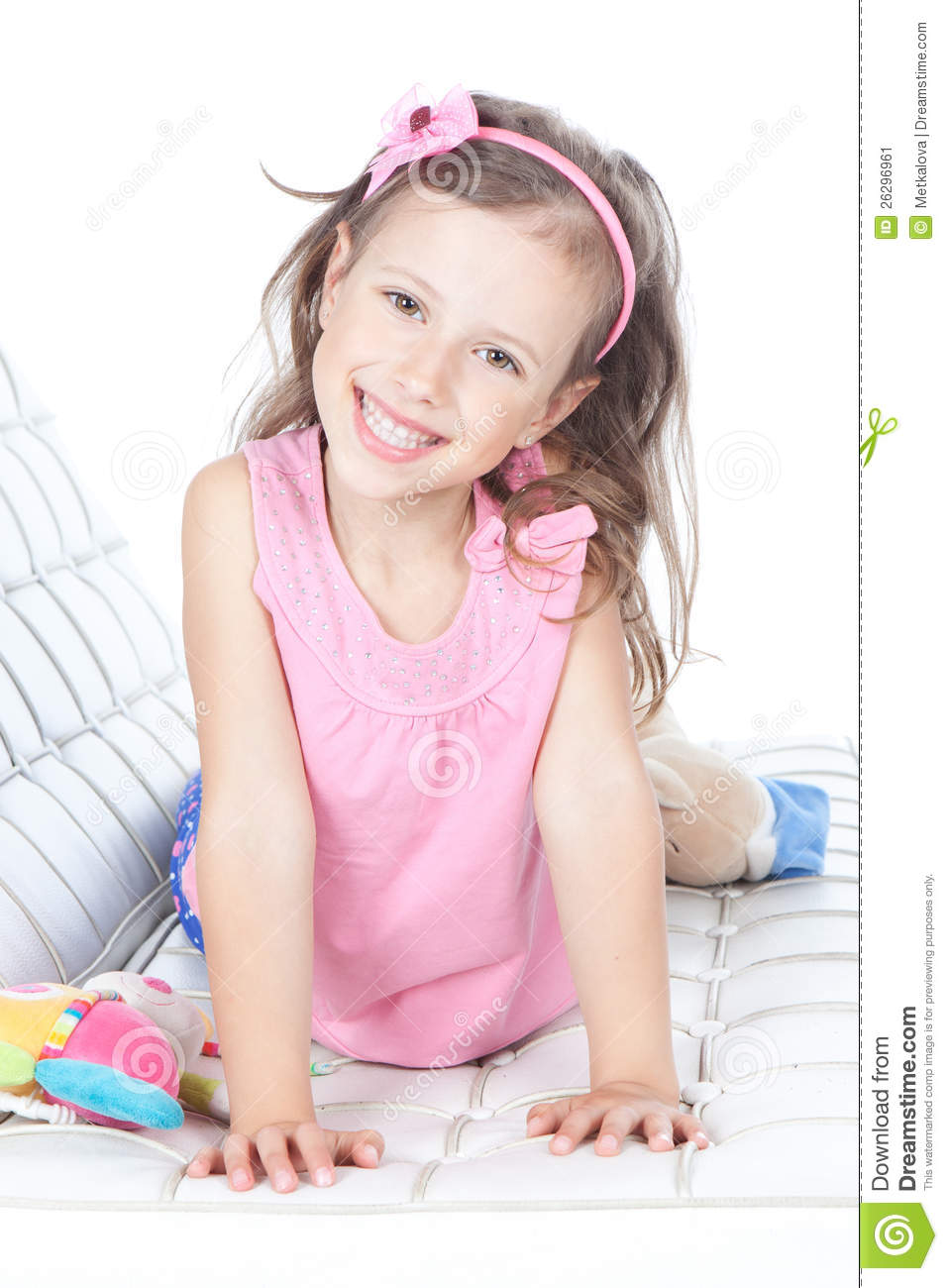 Beautiful Little Girl Lying On A Sofa Stock Image - Image Of Cheerful, Smiling 26296961-3196