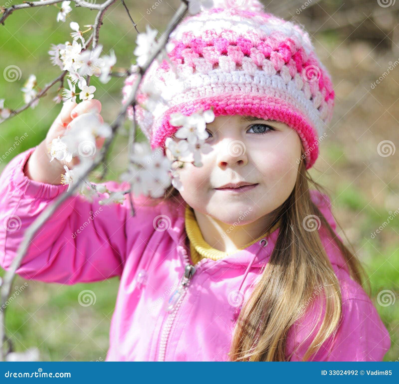 Beautiful Little Girl Bedrooms: Beautiful Little Girl Near A Flowering Tree Stock