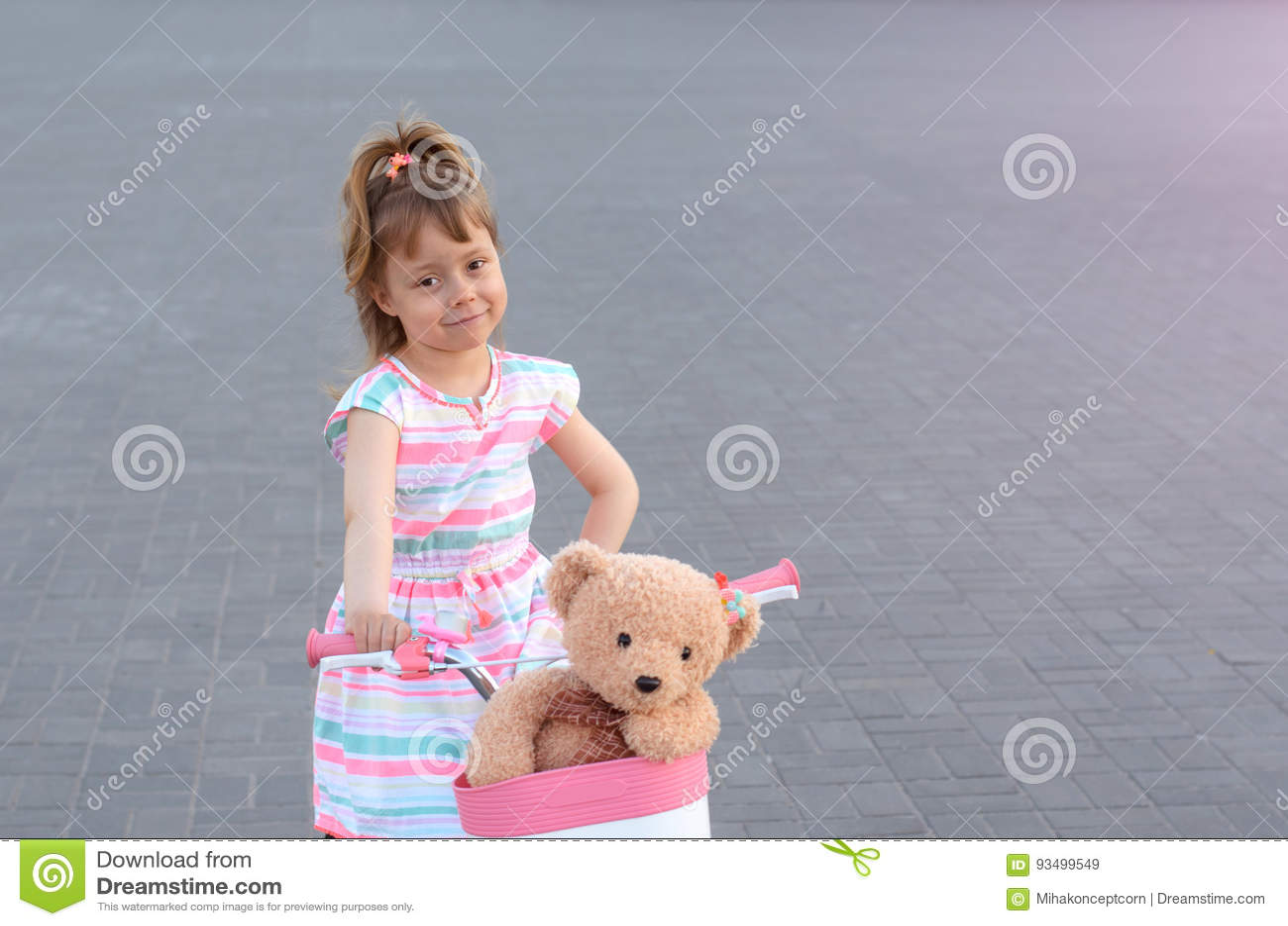 rides teddy bear Girl