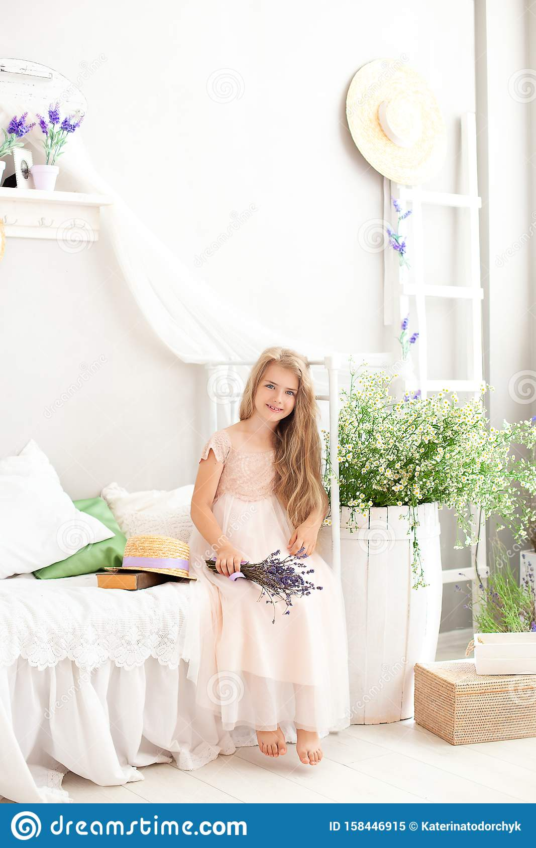 Beautiful Little Girl Sits On A Bed In Bright White Bedroom With Rustic Interior Childhood Concept Provence Style C Stock Image Of Design Farmhouse 158446915