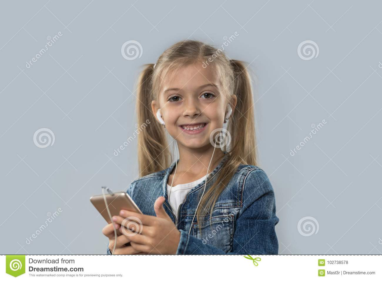 Beautiful Little Girl Using Cell Smart Phone Listen Music Wear Earphones Happy Smiling Isolated