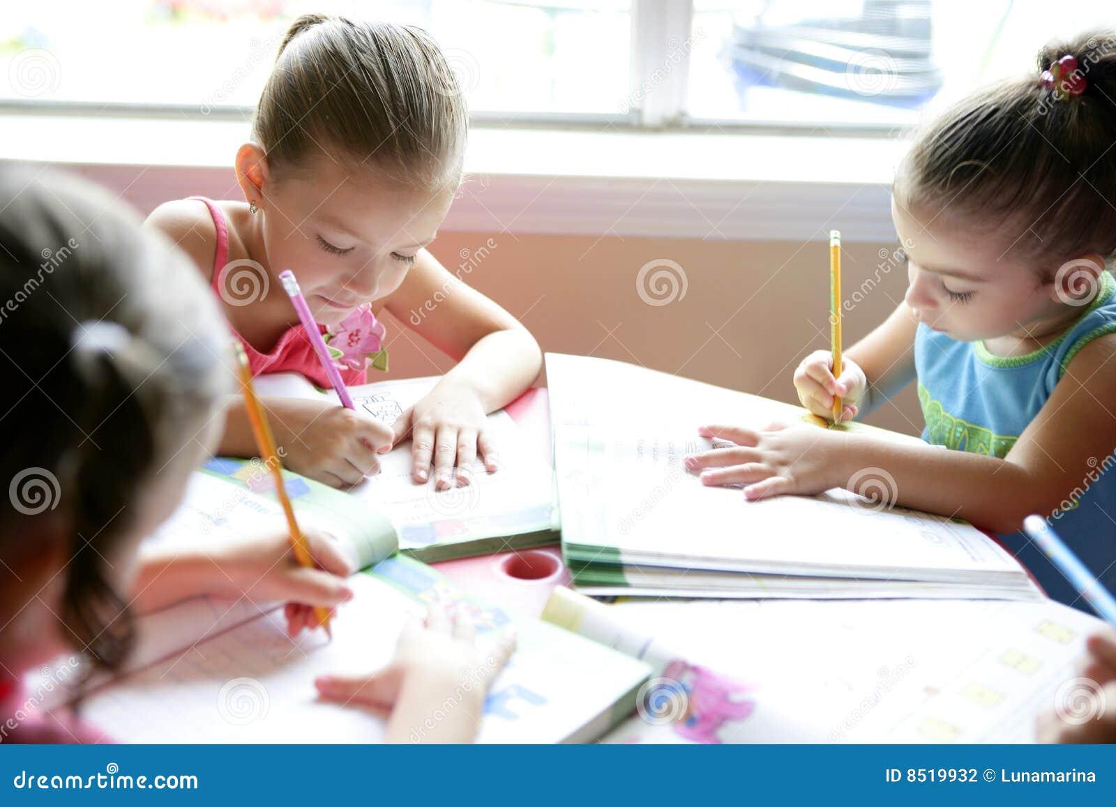 Beautiful little girls, homework at home
