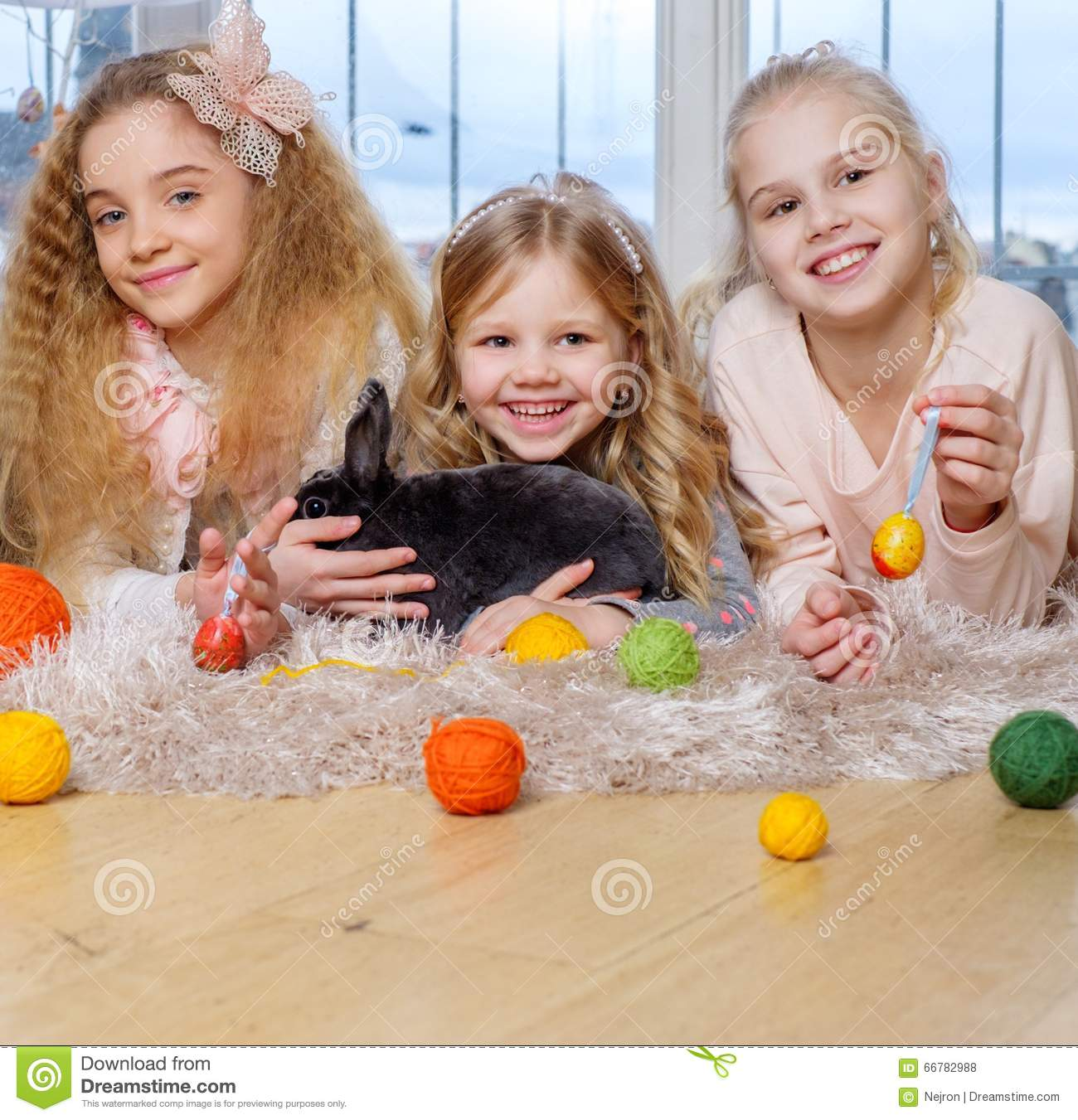 Beautiful Little Girls Lying On Carpet And Playing With