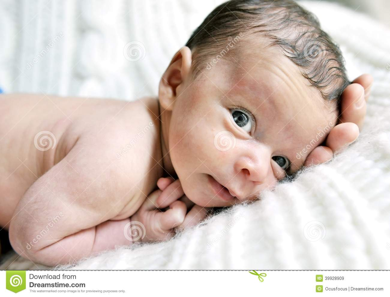 Beautiful little newborn baby in sweet face expression