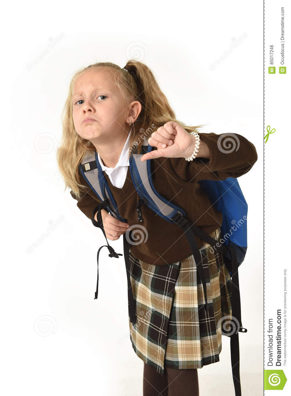 Beautiful little schoolgirl tired and exhausted carrying on her back heavy  school backpack looking sad 8290fd2f8b1f9