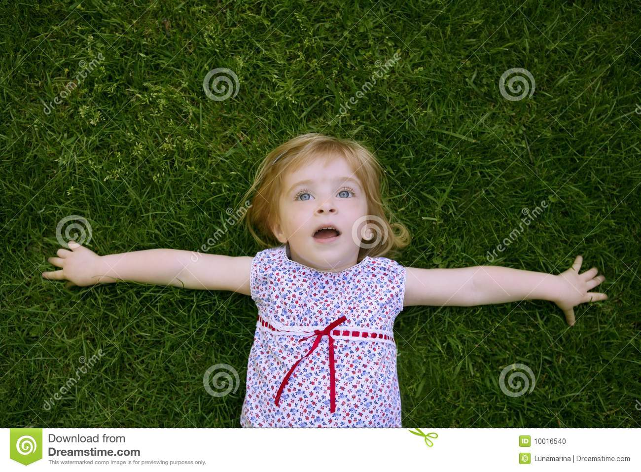 Beautiful little toddler girl happy lying on grass stock photo image 10016540 - Pics of small little girls ...