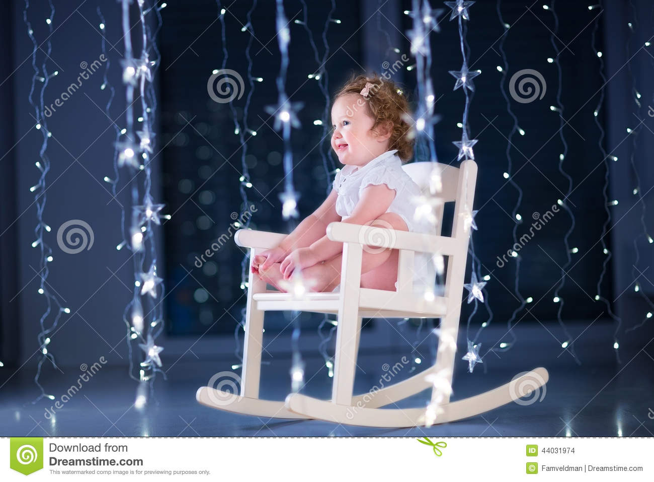 Beautiful little toddler girl in a white rocking chair in a dark room with Christmas lights & Beautiful Little Toddler Girl In A White Rocking Chair In A Dark ...
