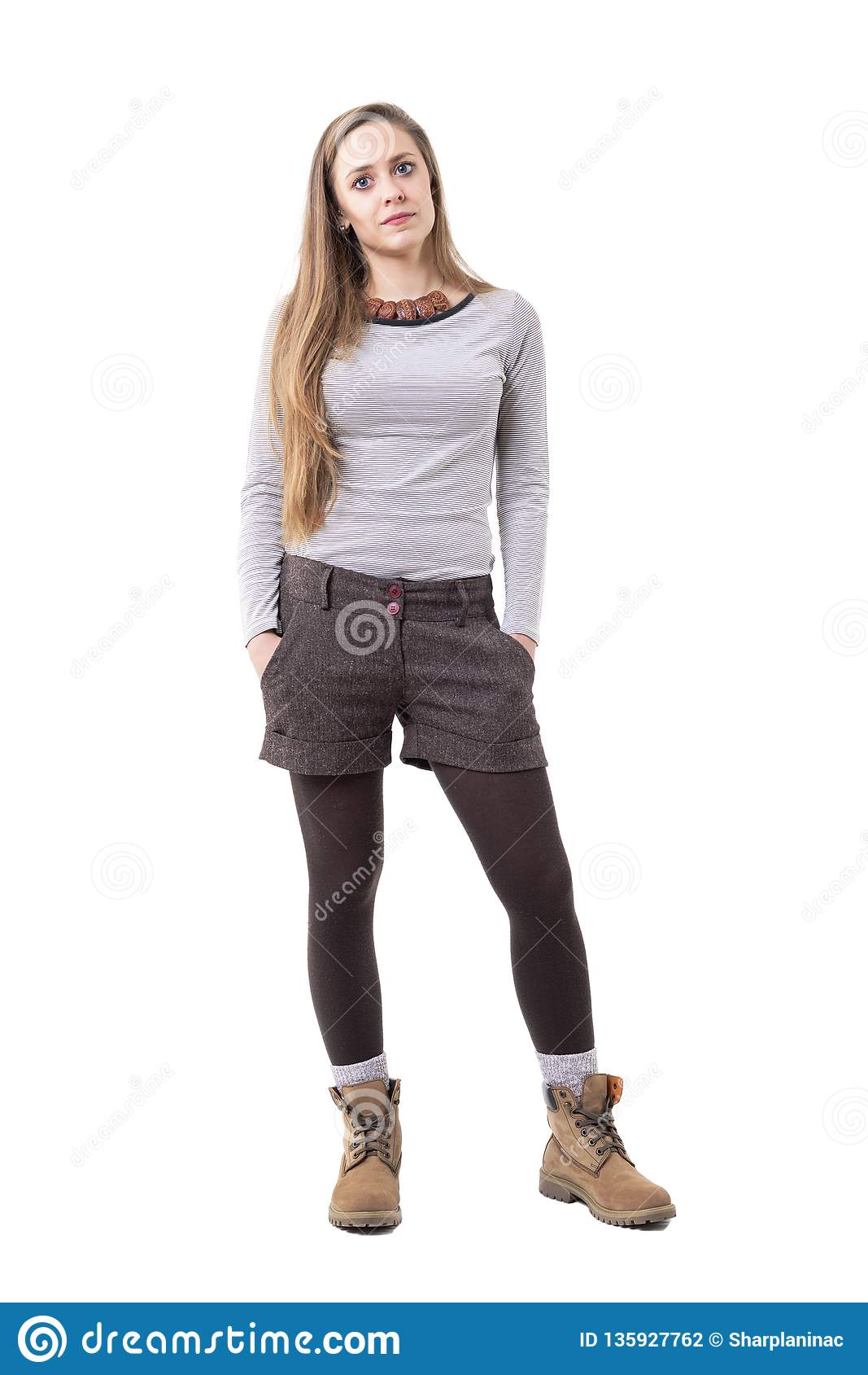 Beautiful long hair hipster girl with authentic clothing styles looking at camera.