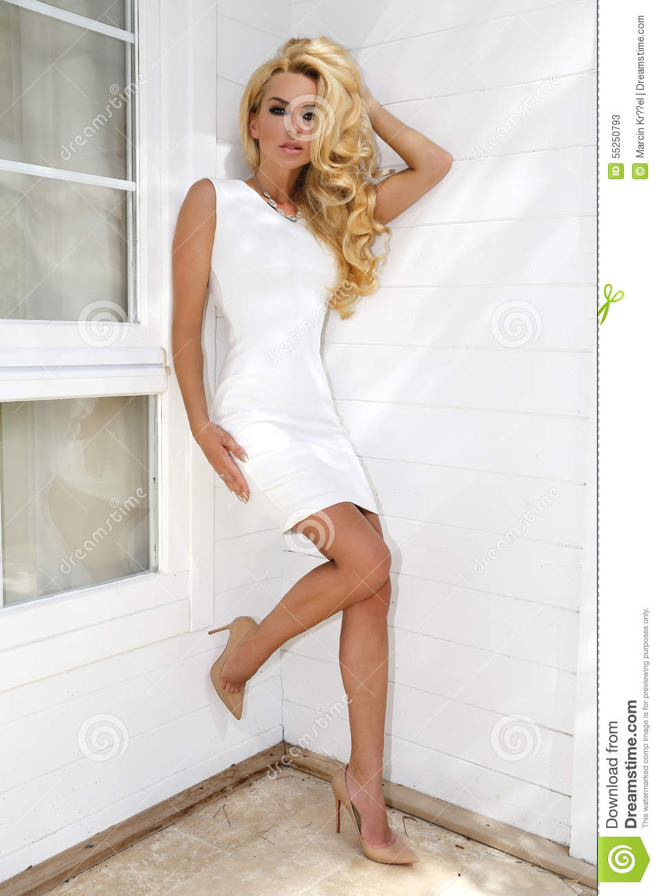 Beautiful Long Haired Blonde Standing Woman In White Short