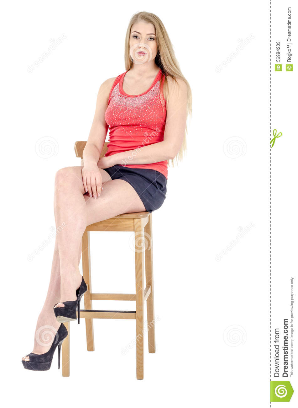 Fantastic Pretty Woman Sitting Outside In A Skirt And Red Shirt Looking Off Into