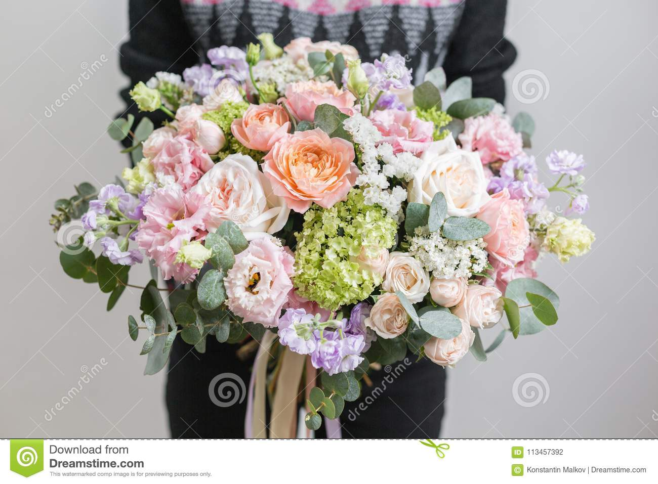 Beautiful luxury bouquet of mixed flowers in woman hand the work of royalty free stock photo izmirmasajfo