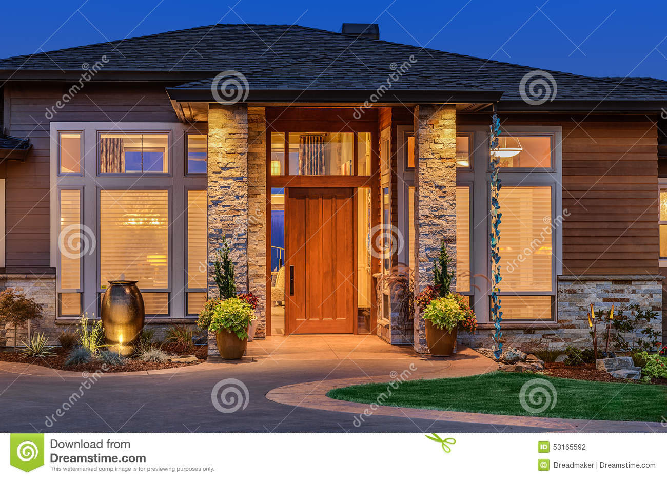 Front Elevation Luxury Homes : Beautiful luxury home exterior in evening with deep blue