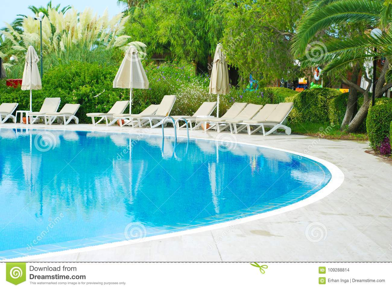 Beautiful Luxury Hotel Swimming Pool Resort with Umbrella and Chairs. Turkey, Side. Summer Vacation.